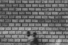 Ahora mira a tu alrededor; nada nos rodea. (Andrea Latasa) Tags: bcn barcelona spain espaa street streetphotography bw blackwhite blancoynegro longexposure largaexposicin pared wall symmetrical symmetry texture