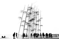 Thessaloniki #1 (Katerina Atha) Tags: thessaloniki umbrellas art bw blackandwhite people minimal landmark