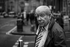 Careful Consideration (Leanne Boulton) Tags: people monochrome depthoffield urban street candid portrait portraiture streetphotography candidstreetphotography candidportrait streetportrait eyecontact candideyecontact streetlife old man male face facial expression eyes look emotion feeling thoughts atmosphere mood pensive thinking tone texture detail bokeh bokehlicious natural outdoor light shade shadow city scene human life living humanity society culture canon 5d canon5dmkiii 70mm character ef2470mmf28liiusm black white blackwhite bw mono blackandwhite glasgow scotland uk
