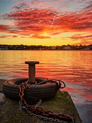 Karmsundet, Norway (Vest der ute) Tags: g7x norway rogaland haugesund reflections quay tire sky sunset clouds chain mooring seascape water fav25 fav200