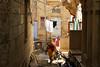 Small alley in residential area, Jaisalmer, India ジャイサルメール、住宅街の生活感ある路地 (travelingmipo) Tags: travel photo india asia 旅行 写真 インド アジア rajasthan ラジャスタン ラジャスターン goldencity ゴールデン・シティ jaisalmer ジャイサルメール street road residential alley 路地 路地裏 生活感 people woman