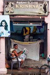Tailor Shop in Triplicane, Chennai (ShivRamky) Tags: street people india newspaper chair streetphotography lifestyle chennai mansitting tamil tamilnadu tailor streetshot parthasarathi triplicane thiruvallikeni shivramky