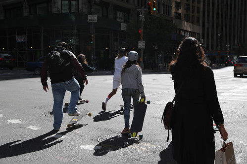 Skaters on Broadway about to kick off after waiting for a red light at 57th Street.