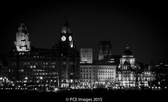 Three Graces (Charliee1972) Tags: blackandwhite architecture liverpool river cityscape waterfront olympus nighttime bnw mersey 3graces