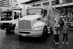Waiting by the Coca-Cola truck. (poopoorama) Tags: seattle family blackandwhite bw usa kids truck children washington fujifilm cocacola pikeplacemarket xseries x100t