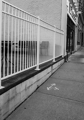 Directed Away From The Fence (Catskills Photography) Tags: hff fence sidewalk arrows blackandwhite streetphotography urban canons95
