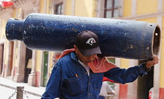 Heavy Load, Street Portrait (klauslang99) Tags: streetphotography klauslang guanajuato mexico person portrait heavy load carrying canister man