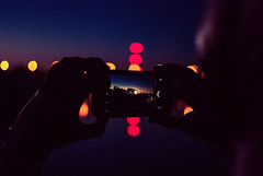 cellular (ewitsoe) Tags: iphone ewitsoe mobile nikon d80 35mm street city bokeh river warta poznan hands night summer evening lights water reflection urban man
