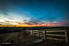Farthing Downs (Alex Chilli) Tags: farthingdowns surrey coulsdon sunday december winter walk fence gate field tracks sunset hills downs sky red orange blue sun canon eos 70d