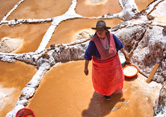Working in the Salt Pans (sussexscorpio) Tags: sping peru saltpans maras salt pools colours evaporation mined people southamerica canon canon60d working qoripujio qoripujiospring terraces family salinasdemaras salineras valley hillside terraced hat outdoor color red white