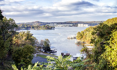 A View from the Bagnel Dam Strip. (SteveFrazierPhotography.com) Tags: lakeoftheozarks lakeozark camdencounty view scene scenery landscape lake evening water autumn fall color foliage trees leaves sky horizon island waves road roadway october2016 clouds reflection vacation parkway pkwy hh villageofthefourseasons outdoor shore shoreline stevefrazierphotography resort horseshoebend hazy rocks roads hills boats motorboat speedboat wake bagneldam missouri mo cloudy overcast condos resorts docks fishing fisherman recreation watersports