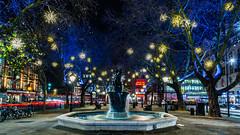 Sloane Square Festive Edition (JB_1984) Tags: sloanesquare festive lights christmaslights christmas fountain lighttrails movement motion blur trees traffic chelsea royalboroughofkensingtonandchelsea london england uk unitedkingdom