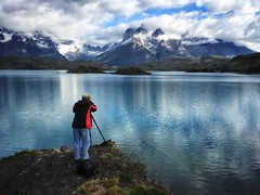 Patagonia (Costa Rica Bill) Tags: photographythemes nature mountain beautyinnature photographing fulllength water lake oneperson scenics mountainrange outdoors lifestyles standing tripod day sky men photographer people patagonia chile