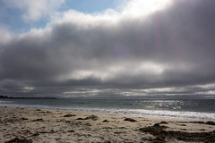 Dark Coast (nosha) Tags: ocean california sea usa sun beach beautiful beauty clouds dark coast apocalypse flare pacificgrove asilomar sunbeam nosha darkcoast