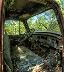 With A Few Parts We Could ...... (Brian Rome Photography) Tags: travel abandoned truck rust cab seat ripped rusty urbanexploration torn deserted steeringwheel urbex mcleans