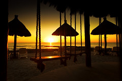 Swingers Sunrise (RonnieLMills) Tags: bar sunrise swings ropes swingers parasols sunbeds