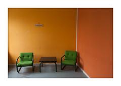 Two Green Chairs in an Orange Corner (csinnbeck) Tags: light summer orange green lines yellow corner canon table denmark eos 350d chairs room lounge explore barracks 1740mm 2007 kaserne 1740l barrack randers explored