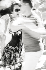 corazn (Super G) Tags: nikon288 redwoodcity california redwoodcitysalsafestival salsa blackandwhite bw candid dance motion blur intentional passion woman man embrace