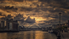 Tarnished Gold (whistlingtent) Tags: stormy gold clouds moody newcastle upon tyne millennium bridge sage gateshead people golden baltic centre contemporary arts reflections streetlamp outdoor skyline sunset water walking dramatic drama