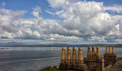 a Scottish castle rooftop flak ;) (lunaryuna) Tags: scotland isleofmull duartcastle lochlinnhe castleroof rooftop chimneypots rooftopflak funny sky clouds cloudscape water landscape seascape weathermood lunaryuna