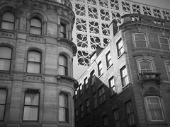 the good the bad and the ugly (vfrgk) Tags: buildings buildingdetail architecture architecturalphotography urban facade windows pattern lightandshadows alley lookup lookingup modern monochrome blackandwhite bw streetphotography urbanphotography urbanfragment urbanart cityscape citycenter