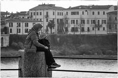 A little smile (Roberto Spagnoli) Tags: fotografiadistrada streetphotography ragazza girl fiume river biancoenero blackandwhite people case houses velo veil sorriso smile
