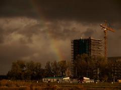 Bij Regen en Zonneschijn (Skylark92) Tags: nederland netherlands holland amsterdam oost zeeburgereiland clouds rainbow building site crane windn sails regenboog donkere lucht wolken nieuwbouw heiskraan