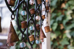 Windchime (melike erkan) Tags: outdoor windchime chimes bokeh dof vintage retro textures rust rusted old beautiful lovely pretty beads green bronze blue metal glass porch leaves