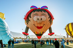 Balloon Fiesta 2016 | Oons Wiefke |  Morning Ascension, 07:38 AM (Facundity) Tags: braids hotairballoons aibf albuquerqueinternationalballoonfiesta balloonfiesta2016 balloonfiestapark morningascension specialshapes smile newmexico albuquerque outdoorphotography eventphotography outdoor face oonswiefke wife whimsical canoneos70d
