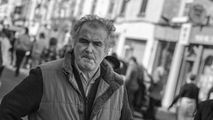 Man on a mission (Frank Fullard) Tags: frankfullard fullard candid street expression hurry mission portrait harassed galway irish ireland mono blackandwhite anxious smoker cigarette serious determined ballinasloe horsefair fair horse