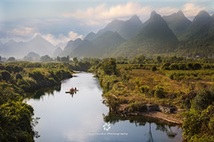 Bamboo Rafting on the Yulong River (fesign) Tags: asia autumn boat bush china chinaeastasia chineseculture colour day destinations guangxi guangxizhuangautonomousregionchina guilin horizontal idyllic image karstformation landscape mountainrange oriental outdoors photography river riveryulong riverbank scenics sunny thepast tranquilscene transportation travel tree yangshuo