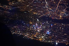 blurry Times Square from the night sky (nicknormal) Tags: nyc night airplane queens timessquare eastriver empirestatebuilding queensborobridge timessq triborobridge