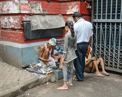 Shoe shiner does his job at street of Kolkata (phuong.sg@gmail.com) Tags: poverty street old travel people india man money male public smile work happy person shoe asia shine place market indian rich poor fortune beggar want repair tired sit brushes vendor wax richness misery job shoeshine kolkata shiner cobbler shoemaker hawker wealth necessity indigence penury