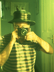 reflected self-portrait with Wirgin Baky camera and black hat (pho-Tony) Tags: old brown 120 film analog vintage germany munich 1930s xpro crossprocessed fuji smooth slide ishootfilm plastic velvia cast munchen analogue veteran 50 expired hue bakelite bellows folder 1934 folding meyer 129 deckel colorcast fujivelvia50 rollfilm 75mm colourcast c41 compur f29 wirgin edixa 45x6 gorlitz tetenal trioplan meyergorlitz 75cm baky fdeckelmunchen 45cmx6cm cameraselfportraits wirginexbaky wirginbaky