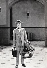 """Bill Magee (Douglas MacLean) arrives at mysterious Baldpate. Scene from """"Seven Keys to Baldpate"""" (Paramount Pictures, 1925) (lhboudreau) Tags: fiction film mystery movie book books romance resort novel robbery silentmovie 1925 paramount moviescene bookart silentfilm hardcover crooks magee motionpicture photoplay movietiein classicmovie vintagebook mountainresort baldpate paramountpictures vintagemovie biggers hardcovers baldpateinn hardcoverbooks billmagee hardcoverbook grossetdunlap paramountpicture earlderrbiggers douglasmaclean billymagee fictionstory fictionnovel sevenkeystobaldpate williammagee photoplayedition earlbiggers williamhalowellmagee"""