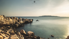 Summer's gone... Or not? (GeorgeVog) Tags: longexposure sea sun sunlight color colour beach water rock canon landscape outdoors daylight george seaside rocks soft long exposure outdoor athens greece adobe nd tones attica lightroom vouliagmeni neutraldensity vogiatzoglou