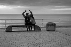 Stretch (evans.photo) Tags: sea sky people october couple candid stretch aberystwyth ceredigion 102015