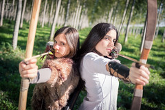 Ready to Shoot - [EXPLORED] (Zano91) Tags: archers archer bow arrow forest woods medieval focus dof girl girls light shadow nikon d7100 sigma 1835 art grass green white brown black hair face weapon cosplay trees tree river ferrara italy photoshoot set bokeh perspective outdoor outside nature portrait creative angle