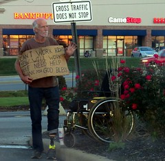 He's been begging for years exposing his prosthetic leg. (kennethkonica) Tags: canonpowershot canon global random hoosiers outdoor talking candid street streetphotography marioncounty midwest america usa indiana indianapolis indy hat people handicap sign neonsign disability beard facialhair culture panhandler beg begging panhandling text bankrupt prostheticleg bluejeans blue bestshotoftheday neon
