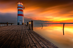 Sunset in Podersdorf (Bernhard Sitzwohl) Tags: jetty longexposure sunset orange red beacon lighthouse podersdorf lakeneusiedl nature landscape