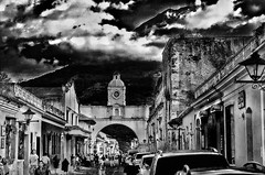 Where heaven touches earth (Pejasar) Tags: sky volcano antigua guatemala contrast bw dramatic arch natural manmade structures buildings street