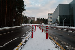 The New Road (modestmoze) Tags: outside outdoors out nature trees green brown shadows road street new 2016 500px novemberwinter snow white clouds sky lithuania vilnius buildings glass windows walls architecture explore travel day cloudy grey black blue red poles lines leadinglines yellow hill city cold dirty wet water