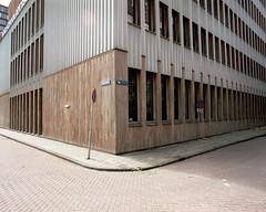 Rotterdam (Jorkew) Tags: wood urban streets building 120 mamiya film architecture mediumformat lens concrete 50mm rotterdam kodak candid parking w nederland 120film f45 sidewalk medium format z portra zuidholland 160 rz67 wijnhaven hogeschool portra160 kodakportra sekor mamiyarz67 parkeerverbod kodakportra160 tenetherlands mamiyasekorz50mmf45w mamiyasekorz