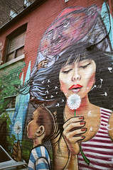Dandelions (Georgie_grrl) Tags: boy woman streetart toronto ontario graffiti expression creative blow seeds pentaxk1000 characters whimsical dandelions makeawish rikenon12828mm elicsr