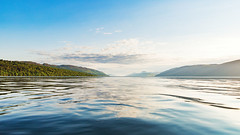 Loch Ness (jaerophoto) Tags: blue summer sky water sunshine canon scotland highlands still bluesky calm loch lochness ness dores greatglen