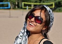 Soma Madam (Debarshi Ray) Tags: summer portrait woman black beach girl beautiful smile sunglasses lady scarf canon finland hair naughty necklace shore wife hanko earrings canoneos70d