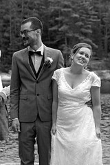 Husband And Wife (peterkelly) Tags: trees wedding bw woman ontario canada man water smile smiling digital forest groom glasses bride dress suit northamerica eyeglasses corsage bancroft silentlakeprovincialpark womenexpression