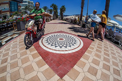 Scooter on the prom. (CWhatPhotos) Tags: cwhatphotos scooter prom promanade people marmaris olympus samyang fisheye fish eye 75mm wide angle prime lens water holiday june 2015 photographs photograph pics pictures pic image images foto fotos photography artistic that have which contain digital bythe bikini blue turkey sea beach wear sand walk sky skies clear day hot sunny sun aegeon aegean turkish hols manual focus