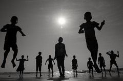 Sunset at Wayangani Beach (kailas bhopi) Tags: konkan konkanphotography monochrome blackwhite childrens childs silhouette wayangani vayanganibeach jumping kids nikond5100 1855mm pointofview nikon sea seashore