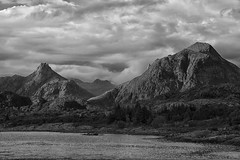 those places wild and wonderful (lunaryuna) Tags: norway lofoten lofotenislands lofotenarchipelago mountains landscape mountaiinrainge fjord water sky cloudscape summer season seasonalbeauty silence soliutude blackwhite bw monochrome lunaryuna